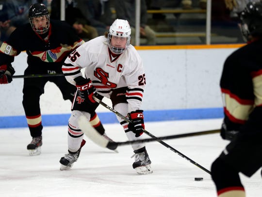 SPASH player Eli Haas sets up to score a goal during a hockey game between SPASH and Pacelli at the K.B. Willett arena in Stevens Point, Wis., January 12, 2018.