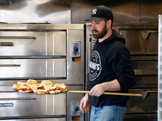 Gianni's Pizzeria Red Bank manager Nick Falabella prepares a tray of Garlic Knot sliders Monday, March 20, 2017.  The Datre family owns this network of five restaurants that are celebrating their 25th anniversary this year.