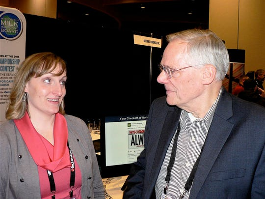 FILE PHOTO - Green Bay farm reporter Mike Austin hears about dairy promotion from Beth Porior-Schaefer of WMMB.