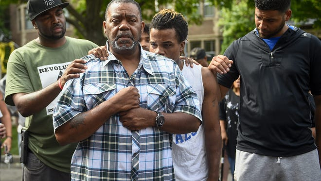 Clarence D. Castile, second from left, uncle of Philando Castile, talks about his nephew outside the governor's residence in St. Paul. Philando was killed by a police officer during a traffic stop.