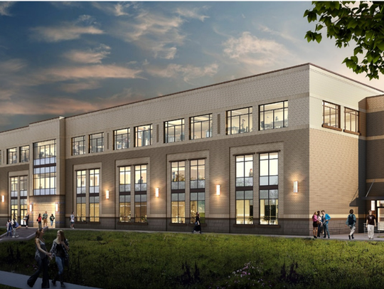 A rendering of a new 3-story academic building located