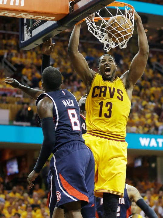LeBron's triple-double helps Cavs top Hawks in thriller