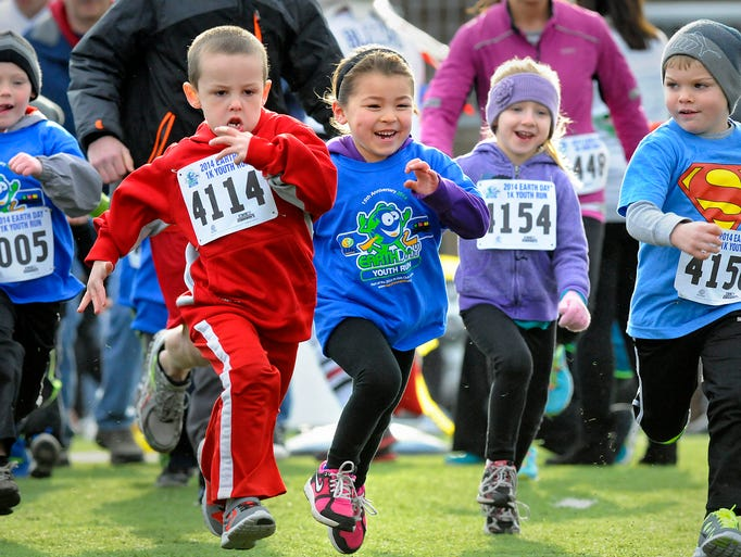 Children take off from the starting line during Friday's Earth Day 1K Youth Run at Husky Stadium in St. Cloud. Competition in a 5K was also held Friday.