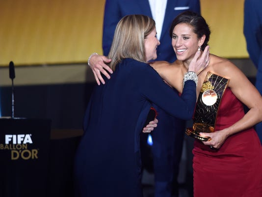 Carli Lloyd of the USA, right, winner of the FIFA Women's soccer player of the year 2015 prize, is congratulated by US soccer coach Jill Ellis, left, winner of the FIFA Women's soccer coach of the year 2015 prize, during the FIFA Ballon d'Or awarding ceremony at the Kongresshaus in Zurich, Switzerland, Monday, January 11, 2016. (Valeriano Di Domenico/Keystone via AP)