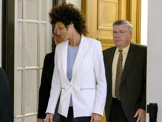 Judge Steven O'Niell declared a mistrial in the case against comedian and actor Bill Cosby at Montgomery County Courthouse in Norristown, Pa., on Saturday June 17, 2017, as Cosby accuser Andrea Constand leaves the courtroom via a back door.