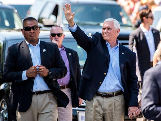 Vice President Mike Pence waves to parade-goers during