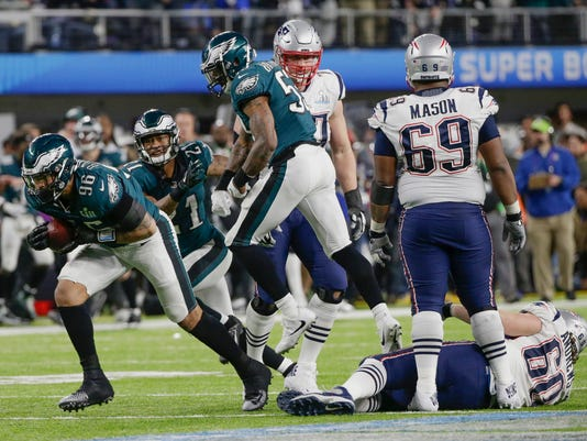 Philadelphia Eagles defensive end Derek Barnett (96) recovers a fumble by New England Patriots quarterback Tom Brady, during the second half of the NFL Super Bowl 52 football game, Sunday, Feb. 4, 2018, in Minneapolis. (AP Photo/Frank Franklin II)