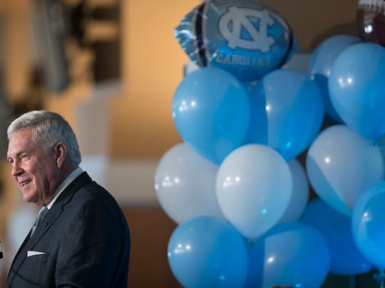 Mack Brown speaks after he was introduced by University of North Carolina's new NCAA college football coach during a news conference, Tuesday, Nov. 27, 2018, at Kenan Stadium in Chapel Hill, N.C. Brown spent 10 seasons at UNC from 1988-97 before leaving for Texas. He left there in 2013 and has been in broadcasting in the years since. (Robert Willett/The News & Observer via AP)