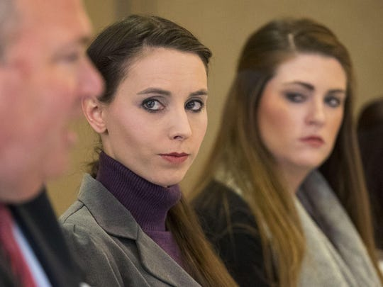 Rachael Denhollander, center, in December 2017 at a press conference.