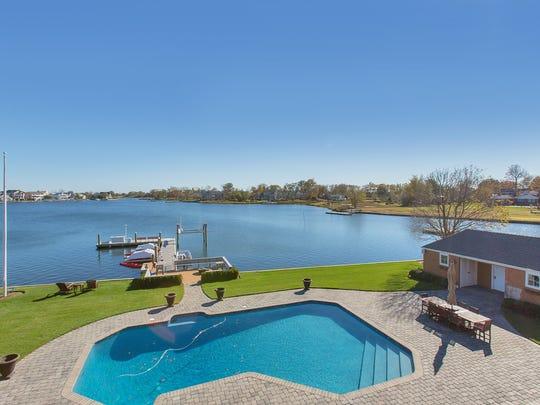 The inground pool overlooks the Shrewsbury River.
