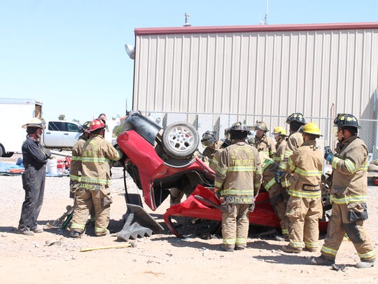 Alamogordo firefighters practice preforming a Clam Shelling on a vehicle during their week long training course behind Fire Station No. 5.