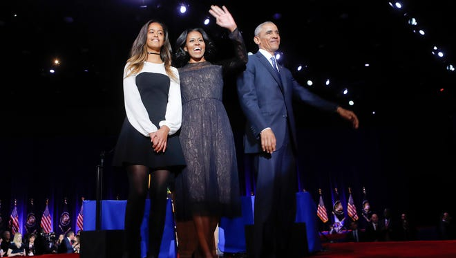 President Barack Obama on stage with first lady Michelle Obama, and daughter Malia, after his farewell address at McCormick Place in Chicago, Tuesday, Jan. 10, 2017.