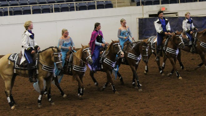 "NIne riders, including these six, represented the Lee County Texas Stars in the drill team competition Monday at the State 4-H Horse Show at the Taylor County Coliseum. Their routine was set to the music of the movie ""Frozen."" Riders also were costumed as characters in the animated movie."