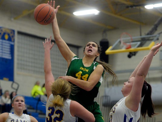 York Catholic's Hannah Laslo shoots against Kennard-Dale's Katelyn Trott in the first half of a girls basketball game at Kennard-Dale on Friday, Jan. 17, 2014. York Catholic defeated Kennard-Dale 58-35. Chris Dunn -- Daily Record/Sunday News