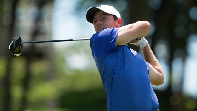 Rory McIlroy plays his shot from the 18th tee during the final round of the Travelers Championship golf tournament at TPC River Highlands on June 25.
