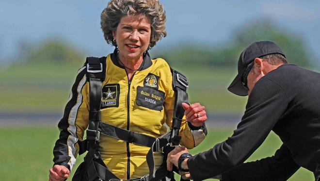 Clarksville Mayor Kim McMillan jumped with the Army's Golden Knights parachute team Thursday.
