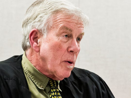 Judge Michael Kupersmith addresses Latonia Congress and her legal team after reducing her sentence during a hearing in Vermont Superior Court in Burlington Friday.