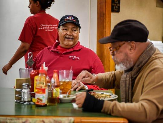 Swett's Restaurant owner David Swett visits with customer