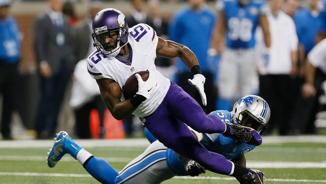 Minnesota Vikings wide receiver Greg Jennings (15) runs after a catch against the Detroit Lions on Dec. 14, 2014.