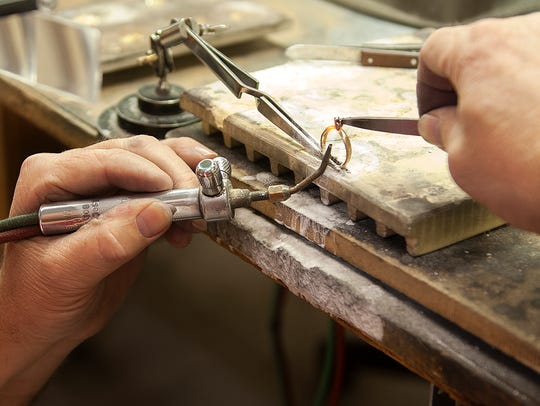 An employee solders a ring for sizing at Val Casting.