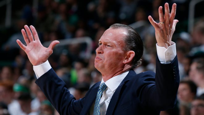 Florida Gulf Coast basketball coach Joe Dooley reacts during the first half against Michigan State on Sunday, Nov. 20, 2016, in East Lansing.
