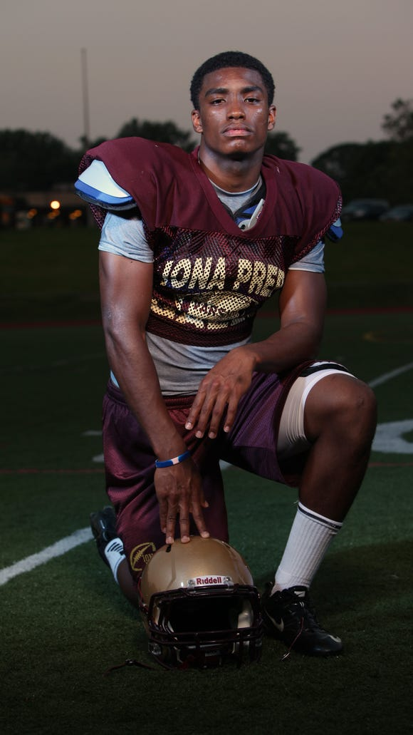 Iona Prep defensive back Chris Cooper is photographed on the field after Iona Prep's football camp at the school in New Rochelle on June 21, 2012.