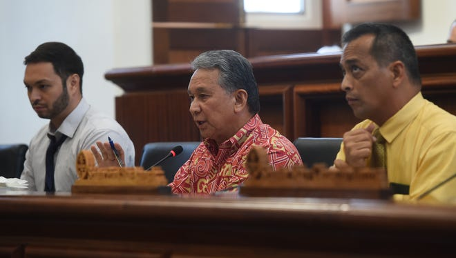 Sens. Michael F.Q San Nicolas, left, Tom Ada, center, and Frank Aguon Jr. listen to testmony by Chamorro Land Trust applicants during an oversight hearing at the Guam Congress Building on May 22, 2018.