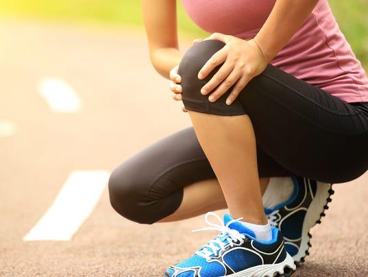 Women holding knee