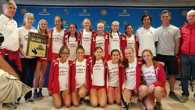 The Foothill Tech girls cross country team poses with the CIF-SS championship plaque after winning the Division 4 title Saturday at Riverside.