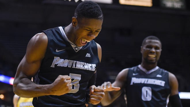 Providence Friars guard Kris Dunn (3) reacts after drawing a foul in the second half during the game against the Marquette Golden Eagles at BMO Harris Bradley Center.