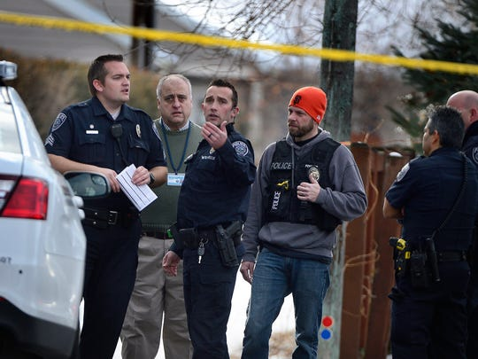 Police talk at the scene of an officer-involved shooting,