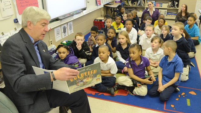 Gov. Rick Snyder reads to first-graders at Dudley STEM School in March 2014. The school would close under a proposal for restructuring Battle Creek Public Schools.