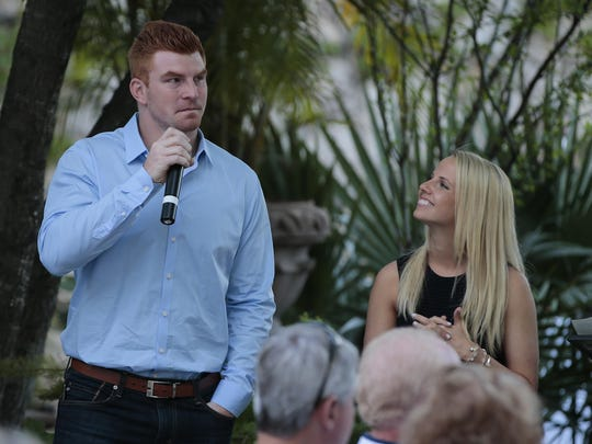 Bengals quarterback Andy Dalton is overcome with emotion as his wife Jordan (right) listens during a fundraising event for the Andy and Jordan Dalton Foundation on April 3, 2016, at his home in Fort Worth, Texas.