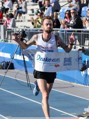 Zach Baker, winning the Drake Relays Road Races Half Marathon on April 20.