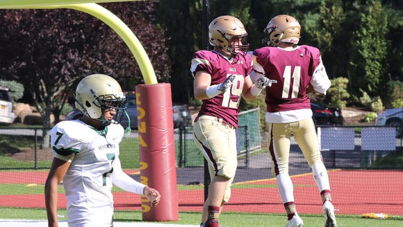 Iona Prep's Matthew Panker, right, celebrates his touchdown