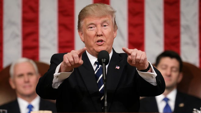President Donald Trump addresses a joint session of Congress on Capitol Hill in Washington, Tuesday, Feb. 28, 2017, as Vice President Mike Pence and House Speaker Paul Ryan of Wis., listen.