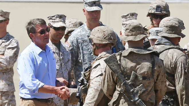 Secretary of Defense Ash Carter greets the troops after they participated in an exercise on Aug. 27, 2015, at Camp Pendleton, Calif.