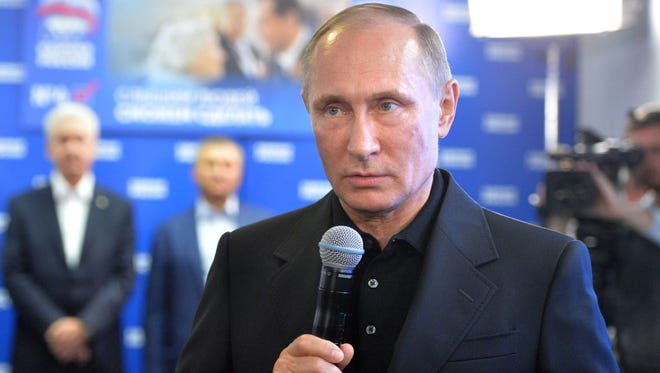 Russian President Vladimir Putin speaks during a visit to the United Russia political party's election campaign headquarters in Moscow on Sept. 18.