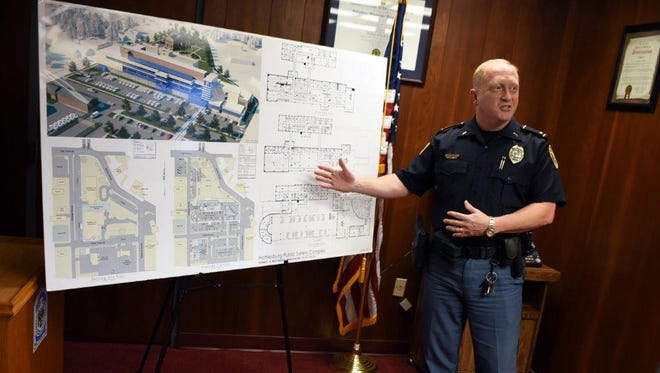 HPD spokesman Lt. Jon Traxler shows plans for the Public Safety Complex. Officials will do a walkthrough of the James Street facility to determine the next stages of salvage and demolition for the old building.