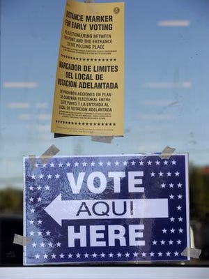 Ronald W. Erdrich/Reporter-News Signs offering information on voting are posted outside Hastings Books and Music on Friday.