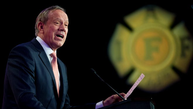 Former New York Gov. George Pataki, reads, as a joke, a fake email transcript from former Sec. of State Hillary Clinton, as he speaks at the International Association of Firefighters (IAFF) Legislative Conference and Presidential Forum on Tuesday in Washington, D.C.