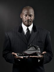 Michael Jordan shows off the 23rd edition of the Air