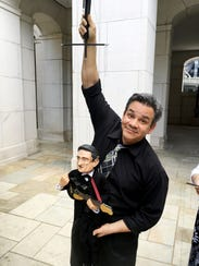 Head Puppeteer Brian Hull shows off the Johnny Cash