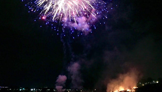 Fire breaks out in the launch area as fireworks explode overhead in Hershey Tuesday night.