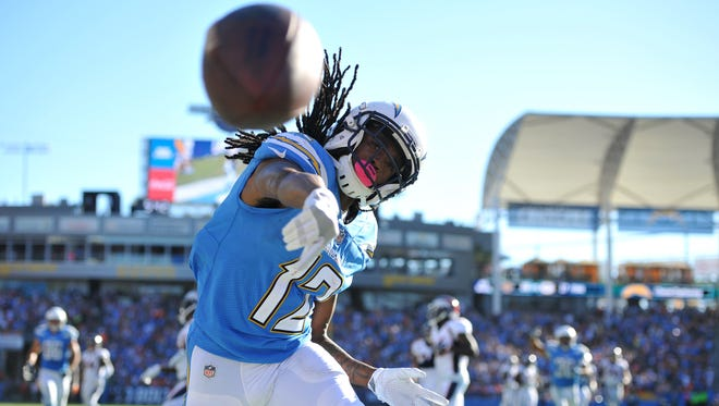 Los Angeles Chargers wide receiver Travis Benjamin throws the football after scoring a touchdown against the Denver Broncos at StubHub Center.