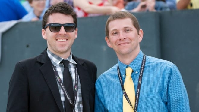 """Jared Welch (left) and Aaron Halterman of Aurora are the """"Racing Dudes"""" and have turned their love of the sport into a business."""