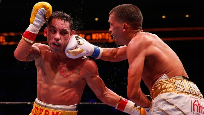 Lee Selby, right, lands a right on Fernando Montiel during their IBF featherweight title bout Wednesday night. (Photo by Christian Petersen/Getty Images)