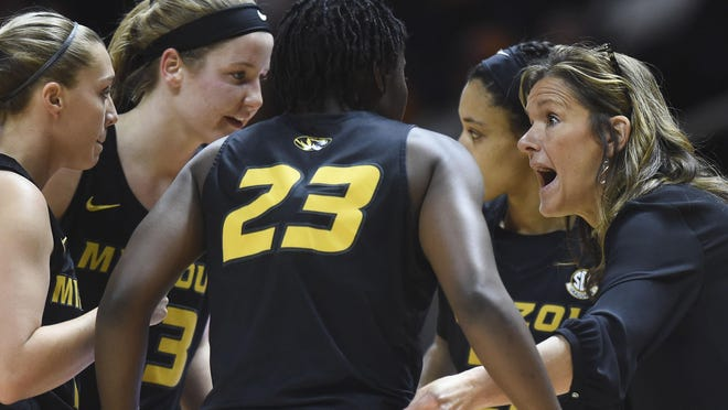 """Missouri women's basketball coach Robin Pingeton talks with her team during a break in a Southeastern Conference game against Tennessee on Jan. 2 in Knoxville, Tenn. Pingeton says she wants """"to be a voice"""" in the fight against racial injustice, and she is having conversations with her team about being part of a movement to bring about significant change."""