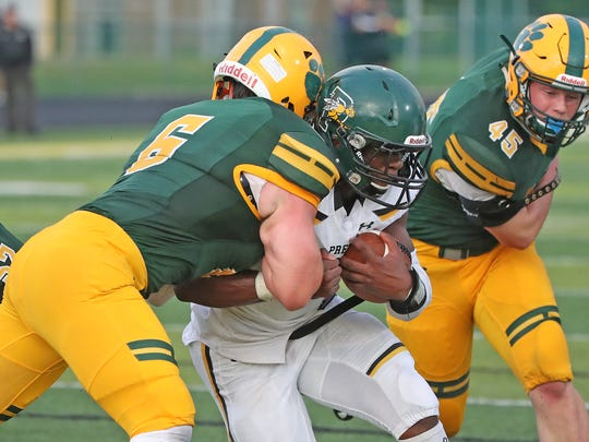 Ashwaubenon Jaguars 225 pound linebacker Camden Wheeler crashes into 215 pound running back Henry Geil at the goal line against the Preble Hornets Thursday, August 17, 2017 at Goelz Field in Ashwaubenon, Wis. Geil stayed on his feet and scored standing up.