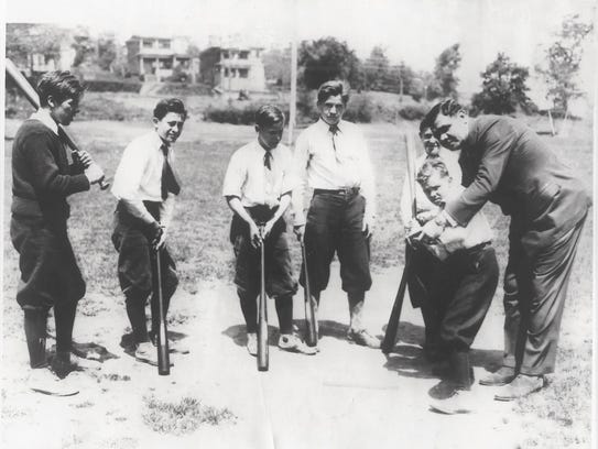 Babe Ruth giving a few batting tips to Johnny Murdock